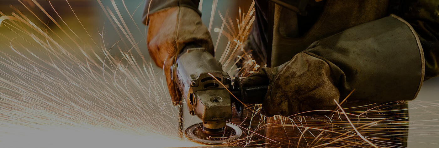 worker-grinding-metal-with-sparks